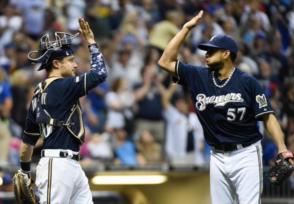 Brewers Catcher Jonathan Lucroy high-fives a teammate last year.