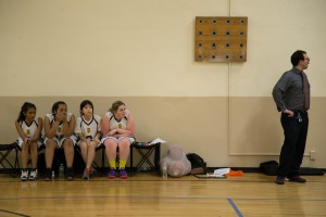 Coach Chapin coaching the girls to victory. Photo courtesy of Hudson Ardizzone-West.