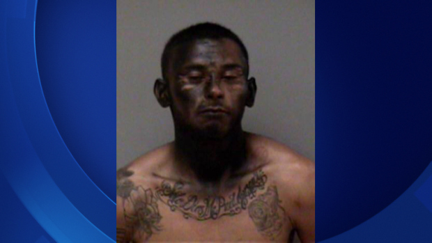 Suspect Jose Esperanza with face spray-painted black after his arrest Saturday, March 14.